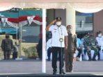 Gubernur Sulawesi Utara Olly Dondokambey menjadi Inspektur Upacara (Irup) pada Apel Gelar Pasukan Operasi Kepolisian Terpusat Ketupat Samrat 2021