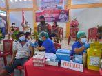 Kapolsek Dimembe Iptu Fadhly S.Tr.K, M.H memantau vaksinasi massal gratis dalam rangka Hari Bhayangkara ke-75